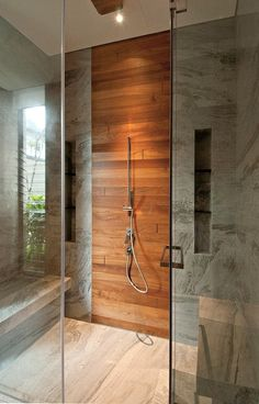 Wood panel - not sure about it in the shower but it is nicely designed and detailed.
