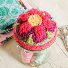 Both pretty and functional! Top a mason jar with  a pretty crochet motif to make this all-in-one sewing kit and pincushion.