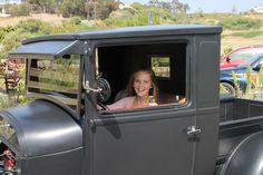 My granddaughter in the '29 Model A - she looks like she fits!