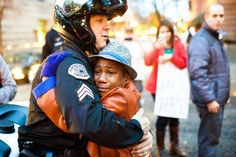 Image of the day...white cop hugs crying black kid...