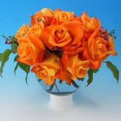rose centerpieces | Traditional roses are also being mixed with spray roses  of the same .