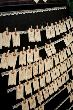 card display: manilla shipping tags, punched with Martha Stewart doily paper punch on bottom edge, hung on lace