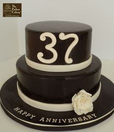 This is a chocolate fondant design our client ordered for her parents' wedding anniversary. A simple ivory frilly flower at the bottom completes this Marriage Anniversary Cake, Anniversary Gifts For Him, Happy Anniversary, Chocolate Fondant Cake, Chocolate Truffles, Cake Writing, Black Forest Cake, Celebration Cakes, Amazing Cakes