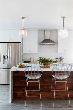 beautiful wood + marble island, white cabinets