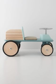 French toymaker Moulin Roty takes us on a peaceful ride through the countryside with their robin's egg blue, retro-inspired tractor. A staple from Moulin's exclusive Les Jouets d'Hier collection, this ride-on toy tractor is built with a flat bed for your little one to hold favorite stuffed animals or beloved blankets that must come along for the ride