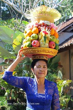 BALI | Of all the top things to do in Bali, perhaps the most special is simply soaking up the island's beautiful culture. Visit a temple, especially during a festival, and you'll see women carrying bowls of fruit on their heads as temple offerings. http://www.sandinmysuitcase.com/top-things-to-do-in-bali/