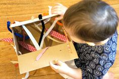 DIY tugging box for fine motor development - Laughing Kids Learn