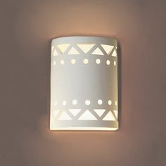 """FABBY's 7"""" Drum Motif Ceramic Sconce sparkles with visual interest in Southwestern themed wall sconce lighting. These wall light fixtures excel far from the Southwest, too. Our wall sconce lights, like all FABBY products, are our own designs exclusive to FABBY. US artisans hand mold each piece in a flawless bisque fired off-white finish. If you wish, you may paint our creations. Acrylic and latex need no primer. Visit us if you are in the Los Angeles area. Custom orders are always welcome."""