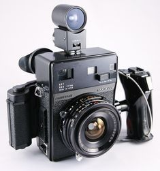 Mamiya Universal rangefinder camera with lens Antique Cameras, Old Cameras, Vintage Cameras, Camera Equipment, Photo Equipment, Photography Equipment, Vlogging Equipment, Camera Hacks, Camera Gear