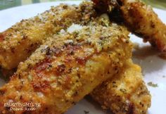 Parmesan Chicken Wings baked in the oven. Simply season your wings with salt & pepper, bake until tender. Then add your favorite Parmesan cheese sprinkling over the wings and bake until golden brown. You can add anything to this, there's really nothing to this simple recipe. Bake on 400 degrees (I don't measure) Enjoy