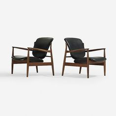 Finn Juhl lounge chairs, pair   France and Sons   Denmark, 1958   teak, vinyl, brass   31.5 w x 30 d x 30 h inches   Signed with metal disc distributor's label to underside of each example: [John Stuart Inc. New York Grand Rapids].