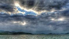 06  Feb. 16:56  暗い冬空にときおり日が射す博多湾です。  Evening at Hakata bay in Japan