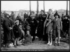 AUSCHWITZ . Jewish mothers and children selected to die in gas chambers. A Nazi SS is taking these pictures. Capturing with his own glee the people and faces of those he knows will be gassed in the hour. With a cold heart and evil, he focuses the f-stop of his camera. What kind of monster did these men become.