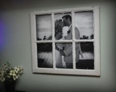 Large photo in an old window pane.