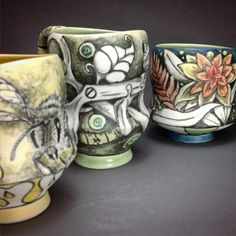 Some cool colorful cups by CJ Niehaus in the Charlie Cummings gallery show.  #ceramics #drawing #porcelain #cjniehaus