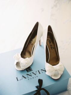 Classic white bow Lanvin pumps: http://www.stylemepretty.com/2016/06/09/they-planned-a-wedding-without-a-neutral-shade-in-sight/   Photography: Abby Jiu Photography - http://www.abbyjiu.com/