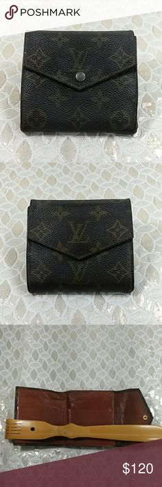 Authentic Louis Vuitton Monogram W Hook Wallet. Canvas showed wearing on the corners due to folding. The was made in France with a date code 8910 AN.The dimension is 4 and 4. Leather showed wearing inside the wallet. Louis Vuitton Accessories