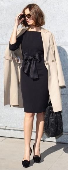 beige trench and black dress