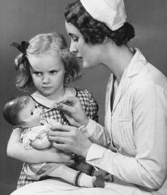 This looks like a photo for an ad; cute girl with her doll who is evidently running a fever! 1940's - 1950's