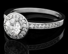 Vintage engagement rings in 18k white gold.