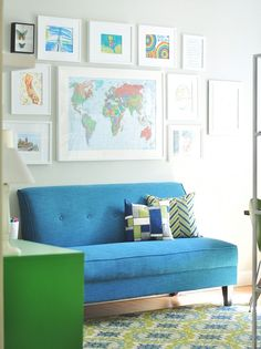 Lovely vibrant furnishings against muted walls draw out the colors of kids' artwork
