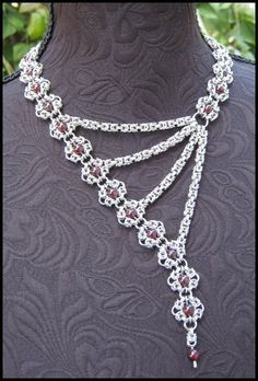 Grandeur Chainmaille necklace.  Lots of garnet filled romanov segments and strands of byzantine ©opyright Immortal Designs