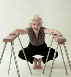 Marilyn. Trestle sitting. Photo by Milton Greene, 1955.