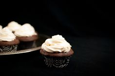 Irish car bomb cupcakes; guiness cocoa cupcakes filled with a chocolate whiskey ganache; topped with a baileys swiss meringue buttercream
