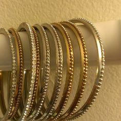 FASHION BANGLES USED ONCE. MIX COLORS. GOLD,SILVER,RED. LET ME LET ME KNOW WHICH ONE YOU LIKE. THERE ARE THREE TYPE OF STYLE. Seven bucks of each picture or you ask for great deal together. FASHION Accessories