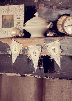 Created with authentic vintage sheet music, snowy white paper shred and linen paper letters. Adorned with vintage white buttons. Draped on 4 feet of jute twine.