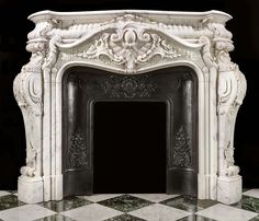 A French Rococo style antique marbke fireplace mantel.