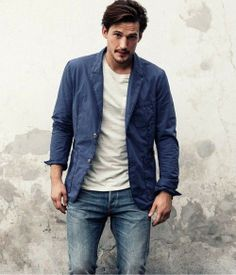 Shop this look for $163: http://lookastic.com/men/looks/white-crew-neck-t-shirt-and-blue-cotton-blazer-and-blue-jeans/2256 — White Crew-neck T-shirt — Blue Cotton Blazer — Blue Jeans