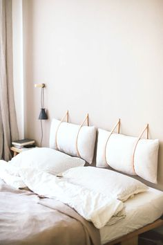 leather straps with pillows headboard. / sfgirlbybay