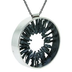 St Martins student Kyle Hopkins' first collection is an enigmatic observation on mankind. Stunning pieces that can be worn by both male or female.    Silver circle pendant with oxidised silver inset people. Silver chain with lobster clasp