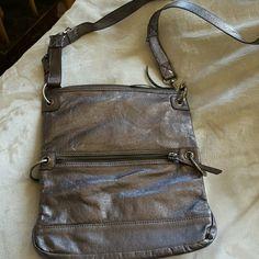 THE SAK pewter shoulder bag Such a nice bag...hardly used. Zippered outside/inside pocket. Nice hardware...pretty fabric inside. 100% leather. Sak Bags Shoulder Bags