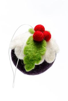 This bauble was made by our new felt supplier in Nepal. the company is owned by a brother and sister, and all the products are hand made due to the very erratic electricity supply