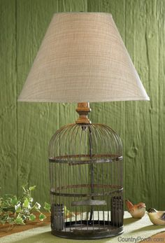 Birdcage Lamp - looks great empty, but I'd probably put a fern in it  ********************************************  TheCountryPorch - #birdcage #lamp  - tå√