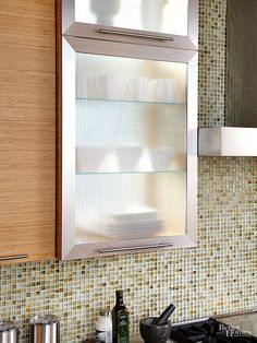 Cabinets rimmed in stainless steel !