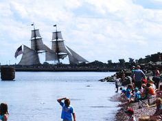 Tall Ships entering Canal Park, Duluth Mn, beach with crowd. www.TwinPortsNightOut.com