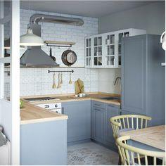 Кухня в серых тонах, кирпичной стеной и фартуком со скандинавским орнаментом. Столовая является частью кухни.