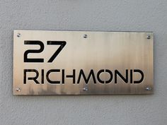 Stainless Steel Sign, Grade 304 with brushed finish and black perspex backing, mounted with Mounting Spacers.