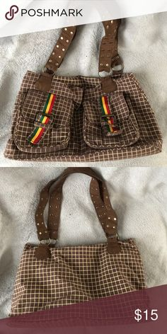 🖤 Dub Wise Rasta Bag Dub Wise Rasta Bag - EUC. Very roomy, super cute with lots of pockets and compartments. Brown checkers with red, gold and green accents and brass hardware.   ❤️Make an offer! Please remember Poshmark takes 20% 🖤Sorry no trades ❤️I ship quickly! 🖤Please accept your packages on the app as soon as you receive them so that the sellers can be paid.  ❤️Please read all descriptions and note condition before you buy. 🖤Bundle your likes for a special deal! Bags Shoulder Bags