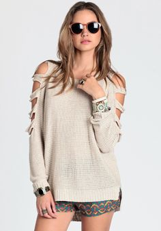 cut out sleeves. could do this with a goodwill sweater.