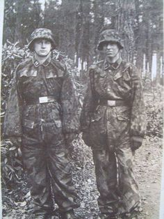 Soldiers from SS-Panzer-Division Hitlerjugend. Their dresses look sort of home made, trousers in Italian camo pattern.