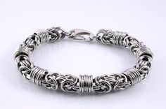 A different take on the classic Byzantine chainmaille weave with added orbiting rings.