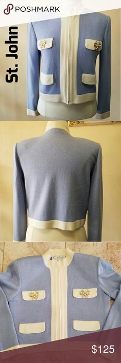 """St. John Sportswear Jacket St. John Sportswear Bomber Jacket in Size P.  Gorgeous light powder blue knit with cream faux pocket flaps. Top flaps have metal butterfly embellishments with faux pearls.  Zip front and contrasting cream colored collar, cuffs and hem. Measurements: Length- neck to hem 17 1/2"""" Width- Bust 18 1/2;armpit to armpit  Sleeve 21 1/2"""" shoulder to cuff St. John Jackets & Coats"""