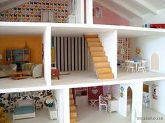 coolest dollhouse ever. would love to make one for little sister one day.