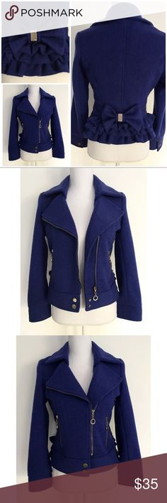 "Cobalt Blue Bows Ruffle Tiers Moto Jacket Gorgeous Rhinestones bow and ruffles detail on the back of this great Moto style jacket. Tag size is a large but fits more like a small. No major flaws except one snap button on the right sleeves pop off. Doesn't really affect the jacket since it still zip up and closed. Measure about 21"" length, 17"" bust, 21.5"" sleeves, 15"" Shoulder to Shoulder ❌No trades. Open to offers. Bundle more to save more. Thank you‼️ Boutique Jackets & Coats Utility Jackets"