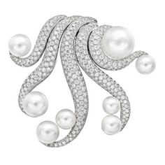 """Verdura """"Octopus"""" South Sea Pearl & Diamond Brooch    """"Octopus"""" South Sea pearl brooch in 18k white gold pavé-set with round-cut diamonds. 339 diamonds weighing 4.15 total carats and eight cultured South Sea pearls. Signed Verdura."""