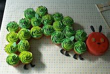 Cupcake cake inspired by Eric Carle's The Hungry, Hungry Caterpillar. Lots of darling designs here at Lyndsay Sung's blog.